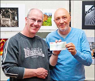 Dave Yate receiving cheque from David Boyce